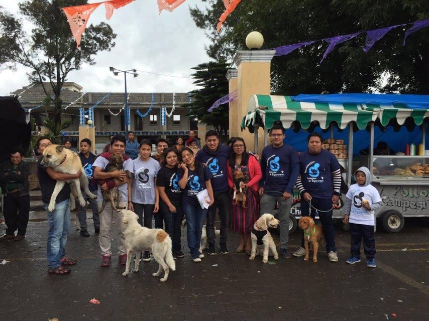 A group of Ladridos de Esperanza volunteers meeting before a children's event they held.