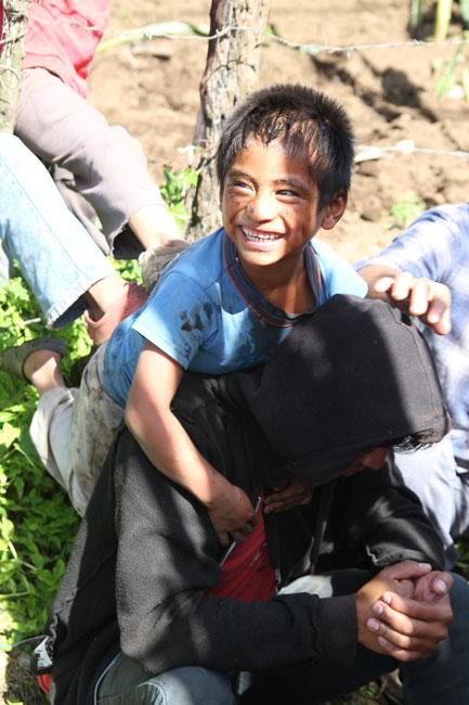 Local boy in Santa Maria with Cosechando volunteer