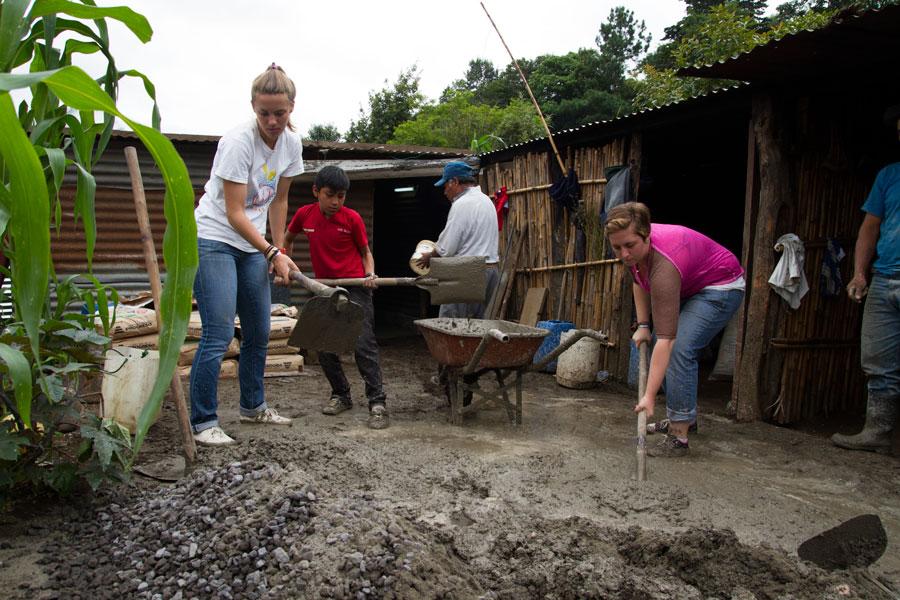 Emily & Brennan helping the mason lay down concrete