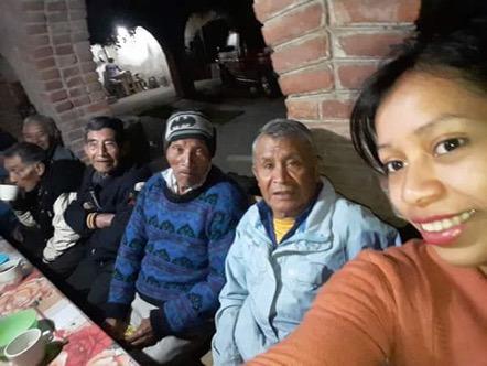 Volunteers serving food at Cosechando Felicidad